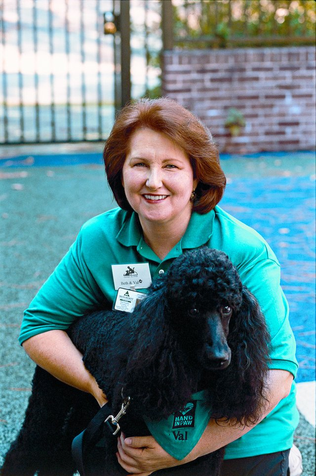 INK-BIZ-HAPPS-Hand-In-Paw-founder-Beth-Franklin-with-Val-copy.jpg